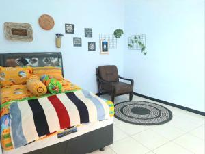 A bed or beds in a room at Villa Fifari