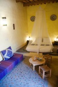 Un ou plusieurs lits dans un hébergement de l'établissement Dar Sofar