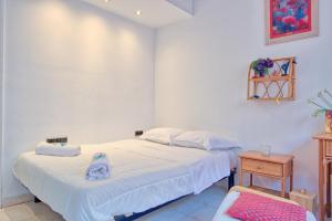 A bed or beds in a room at Le Marceau - Super Studio haut de gamme