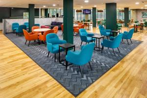 The lounge or bar area at ibis budget London Heathrow T5