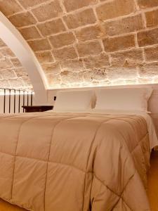 Letto o letti in una camera di Masseria dei Monaci