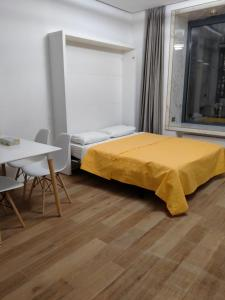 A bed or beds in a room at Match Point GOLD