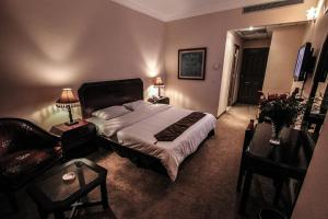 A bed or beds in a room at Inter Hotel