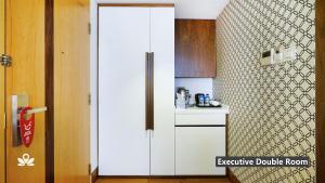 A kitchen or kitchenette at ZEN Premium Kampong Glam