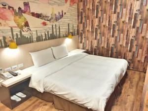三多旅店 - 三多館房間的床