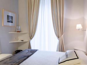 A bed or beds in a room at B&B Il Corso