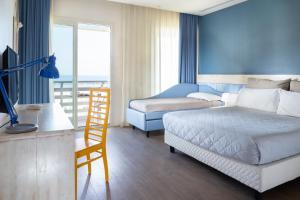 Ein Bett oder Betten in einem Zimmer der Unterkunft Hotel LaMorosa