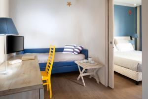 Letto o letti in una camera di Hotel LaMorosa