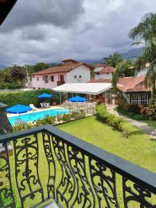 Uma vista da piscina em Pousada Villa Harmonia ou nos arredores