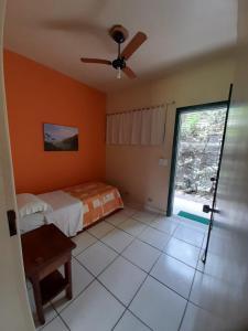 Cama ou camas em um quarto em Pousada Villa Harmonia
