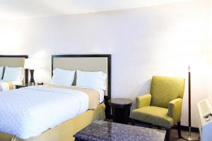 A bed or beds in a room at Argo Inn and Suites
