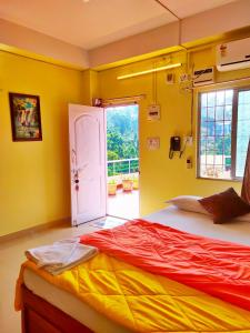 A bed or beds in a room at Kanchan's Nest