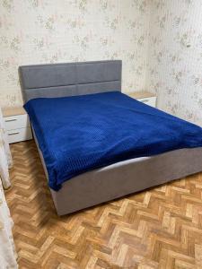 Кровать или кровати в номере Гостевой дом Лазурный