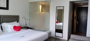 A bed or beds in a room at Sugar Palm Grand Hillside - SHA Plus