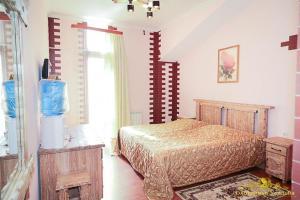 Кровать или кровати в номере Отель Охотничья Усадьба