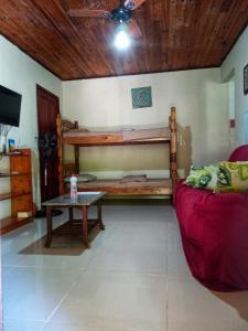 A bunk bed or bunk beds in a room at Guerreiro Das Ondas