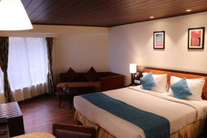 A bed or beds in a room at Sterling Darjeeling