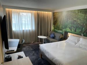 Un ou plusieurs lits dans un hébergement de l'établissement Novotel Rennes Alma