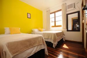 Cama ou camas em um quarto em Pousada Cores de Búzios