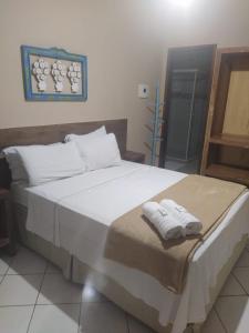 A bed or beds in a room at Pousada Casa do Bosque