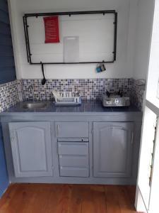 Küche/Küchenzeile in der Unterkunft Cosy Hut
