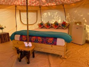 A bed or beds in a room at The Lotus Resort