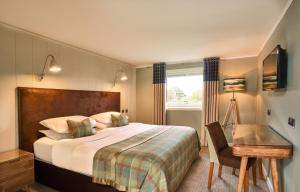A bed or beds in a room at Isle Of Mull Hotel and Spa