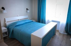 Кровать или кровати в номере Отель Абажур