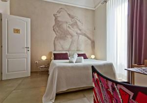 A bed or beds in a room at Artistic Charming House