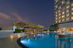 The swimming pool at or near Swissotel Bangkok Ratchada