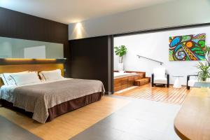 A bed or beds in a room at Hotel Spa La Casa del Rector