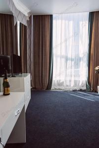 Кровать или кровати в номере Brigantina Hotel