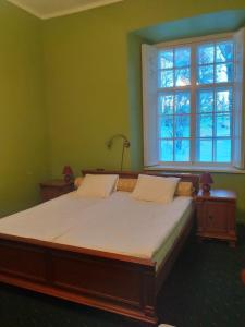 A bed or beds in a room at Palmse Manor Guesthouse