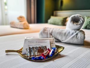Un ou plusieurs lits dans un hébergement de l'établissement Hotel Alexander