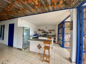 A kitchen or kitchenette at Hostel Beach House