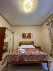 Кровать или кровати в номере Отель Дюма