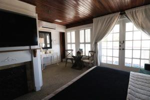 A television and/or entertainment center at The Riverview Hotel - New Smyrna Beach