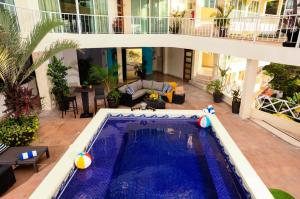 The swimming pool at or close to Blue Chairs Resort by the Sea