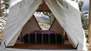 A bed or beds in a room at Domos Cordillera Blanca