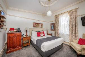 A bed or beds in a room at Cobb & Co Court Boutique Hotel