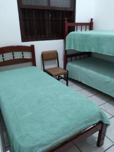 A bunk bed or bunk beds in a room at Vida Boa Beira Mar