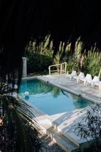 Der Swimmingpool an oder in der Nähe von Residencia El Balatà