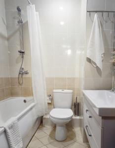 Ванная комната в Apartments and flats Zona Komforta
