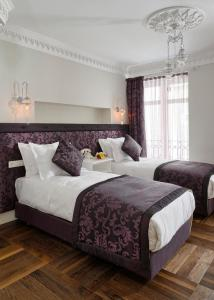 A bed or beds in a room at Nexthouse Pera Hotel