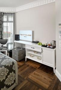 A television and/or entertainment center at Nexthouse Pera Hotel