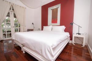 Ein Bett oder Betten in einem Zimmer der Unterkunft Maison Souvannaphoum Hotel