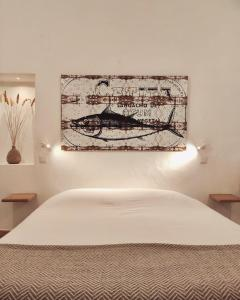 A bed or beds in a room at Farmhouse Of The Palms