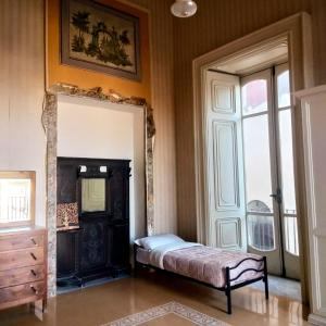 A bed or beds in a room at Salerno Experience