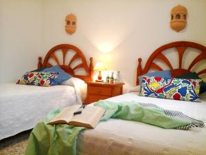 A bed or beds in a room at House with 3 bedrooms in El Golfo Lanzarote with terrace and WiFi 500 m from the beach