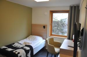 Säng eller sängar i ett rum på Svf Vandrarhem, Hotell & Konferens